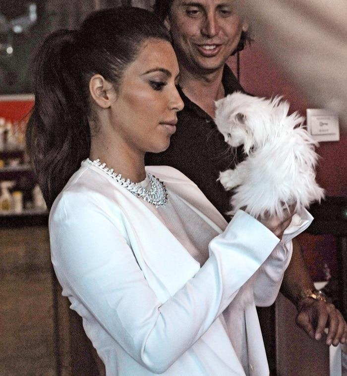Kim Kardashian posing with her white pussy