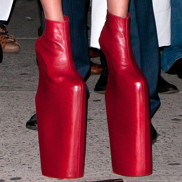 Lady Gaga wearing extreme red curved-heel wedges