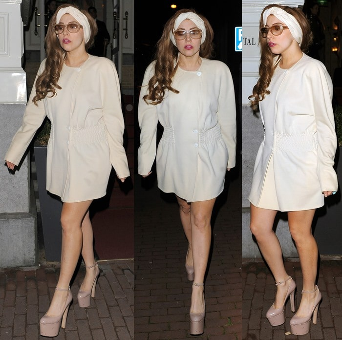 Lady Gaga leaves her hotel late at night and has pictures taken with her fans, who had waited for hours to see her, before getting on a tour bus to take her to Berlin. Lady Gaga also had an assistant handing out free samples of her new perfume, 'Fame' to the fans who had waited all day and night for the singer to emerge from her hotel in Amsterdam on September 19, 2012
