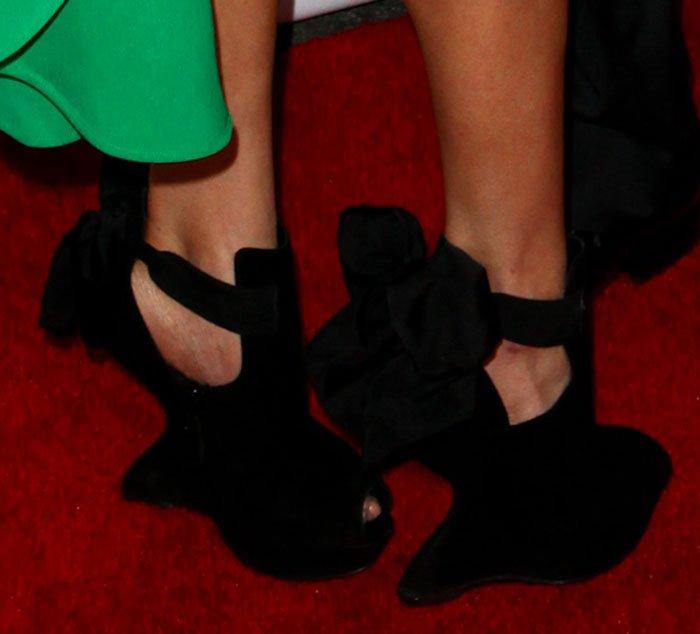 LeAnn Rimes in bow detailed heel-less Alexander McQueen booties