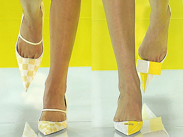 Models strut in checkered pointy toe shoes down the Louis Vuitton Spring/Summer 2013 runway