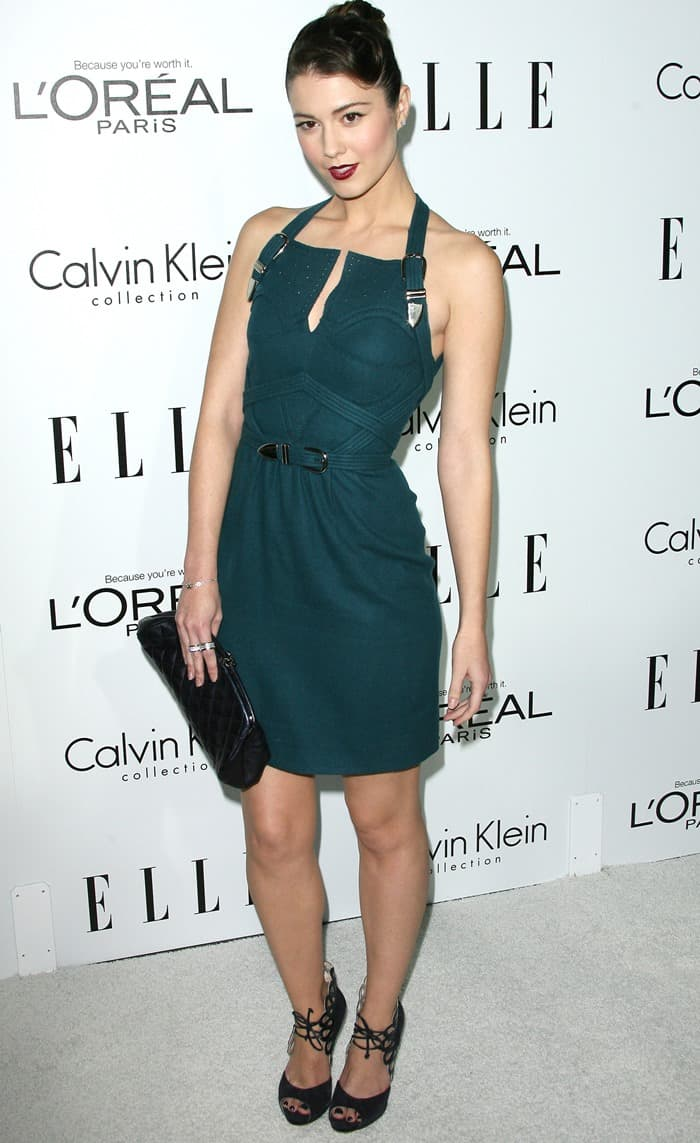 Mary Elizabeth Winstead wearing a dress from the Marios Schwab Fall 2011 collection paired with black suede scallop heels