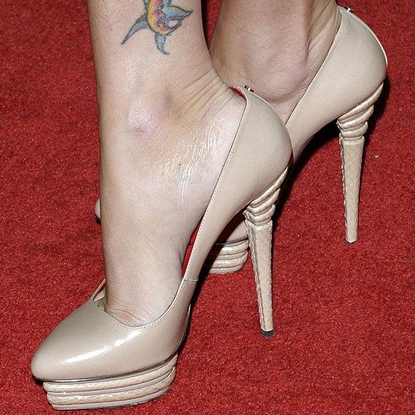 Megan Fox shows off her feet in nude Cesare Paciotti platform pumps