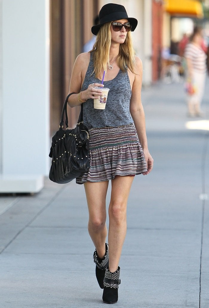 Nicky Hilton toting a black studded Maison Valentino handbag in Beverly Hills on October 16, 2012