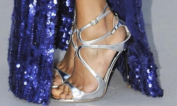 Nina Dobrev's pretty toes in metallic Jimmy Choos