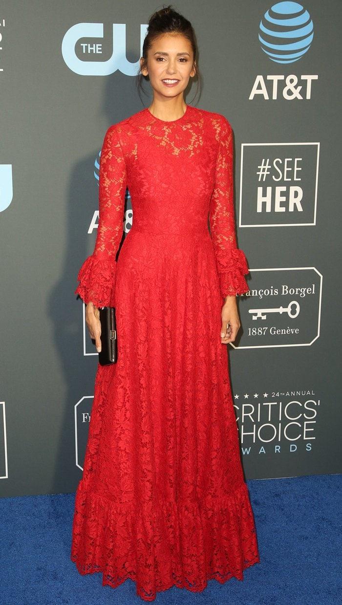 Nina Dobrev was stunning in a red dress at the 2019 Critics' Choice Awards at the Barker Hangar in Santa Monica, California, on January 13, 2019
