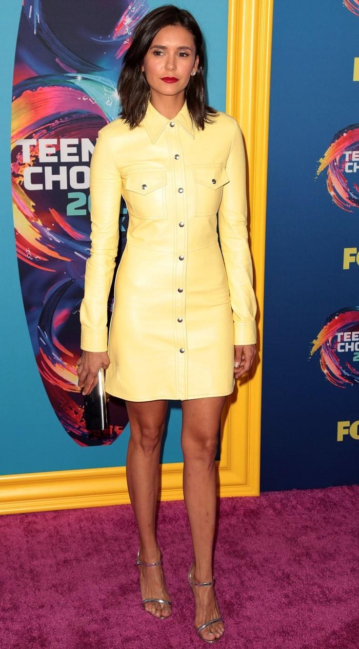Nina Dobrev parades her long stemsat the 2018 Teen Choice Awardsin Inglewood, California, on August 12, 2018