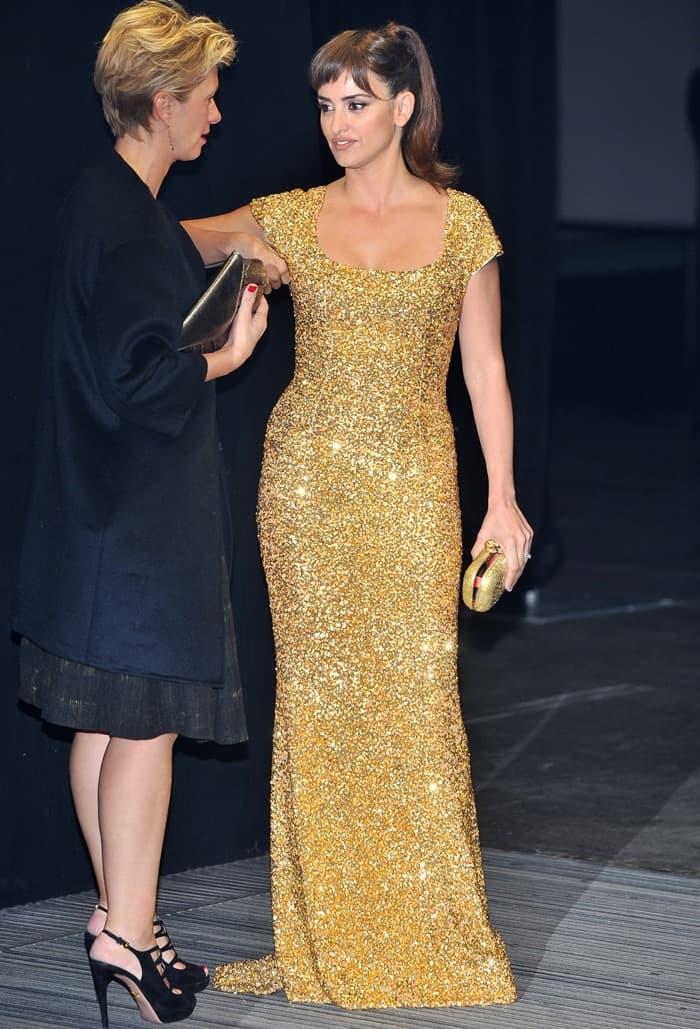 Penelope Cruz wore a floor-sweeping gold L'Wren Scott Fall 2012 gown