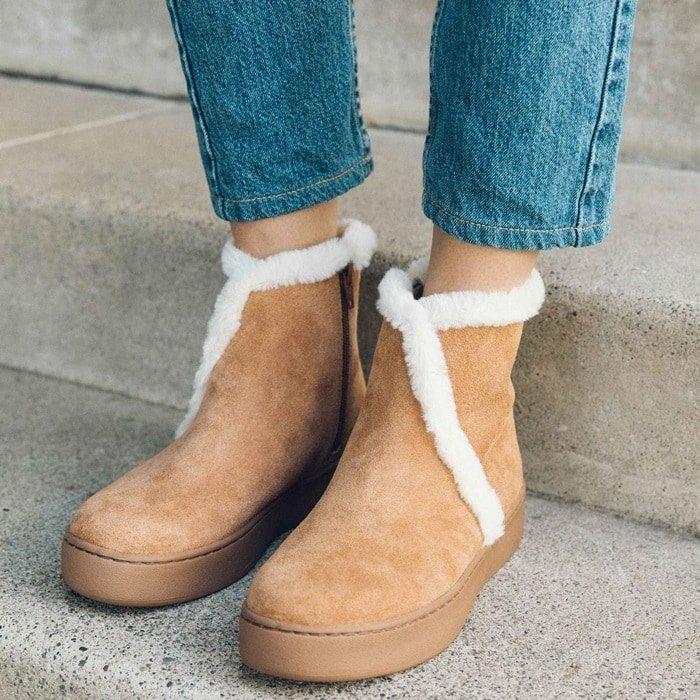 Plush faux fur adds extra comfort and warmth to a winter-ready boot crafted in soft suede and grounded by a platform rubber sole.