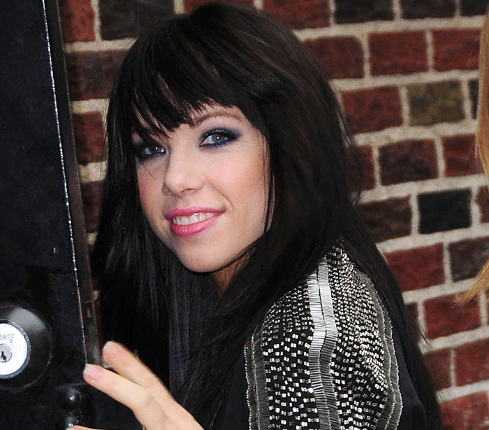 """Carly Rae Jepsen wears her hair down as she arrives at the Ed Sullivan Theatre for her """"Late Show with David Letterman"""" performance"""