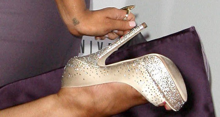 Christina Aguilera shows off her feet in sparkling Jimmy Choo shoes