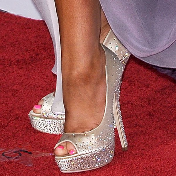 "Christina Aguilera's sparklers are these Jimmy Choo ""Sugar"" crystal-studded satin peep-toe pumps"
