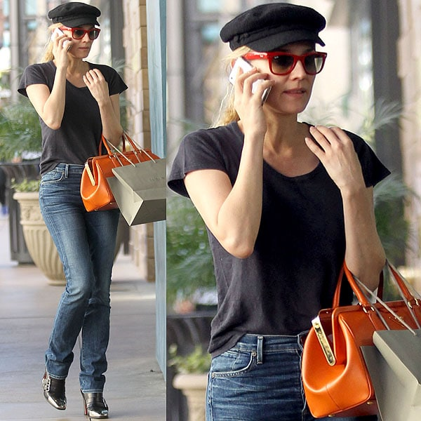 Diane Kruger talking on her mobile phone while walking through The Grove