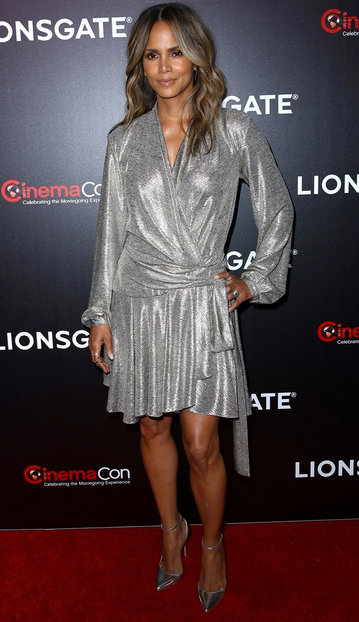 Halle Berry flaunted her legs in a PatBo silver wrap dress with Stella Luna shoes