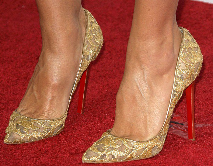 Heidi Klum shows toe cleavage in Christian Louboutin for Vauthier gold pumps