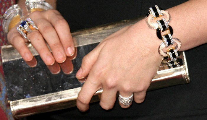 Hillary Scott showing off her jewelry and clutch