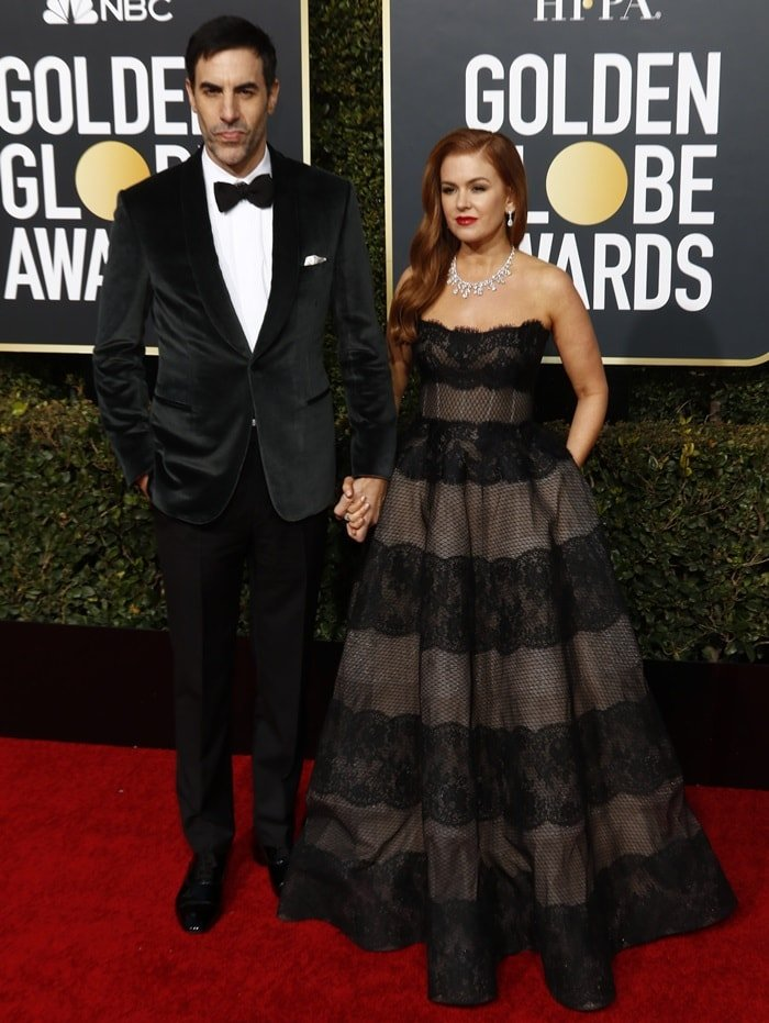 Isla Fisher and Sacha Baron Cohen pose together on the red carpet as they arrive at the 2019 Golden Globe Awards at the Beverly Hilton Hotel in Beverly Hills, California, on January 6, 2019