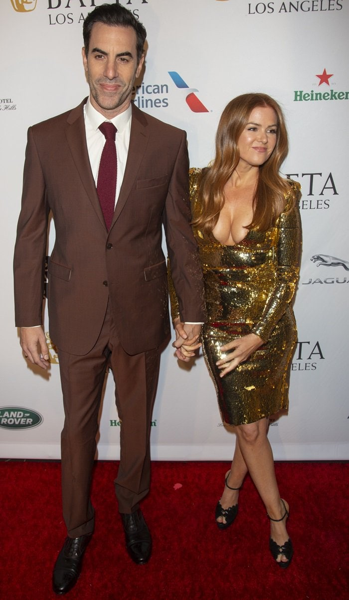 Redhead Isla Fisher flaunts her hot legs in a gold sequined dress by Greta Constantine