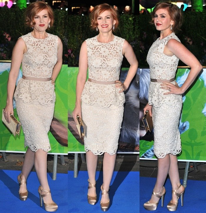 Isla Fisher flaunts her sexy legs in a lace peplum-detailed dress by Dolce & Gabbana