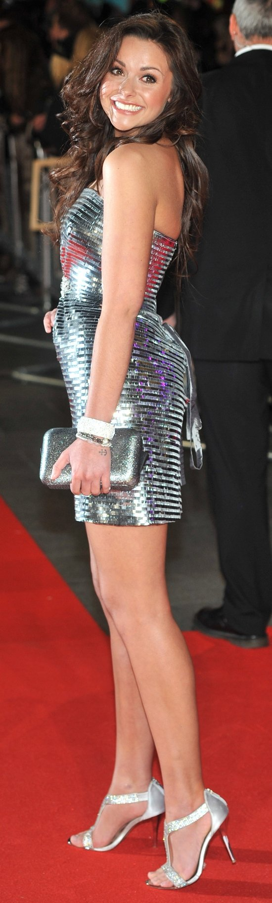 Kelsey-Beth Crossley showing off her legs in a strapless metallic dress
