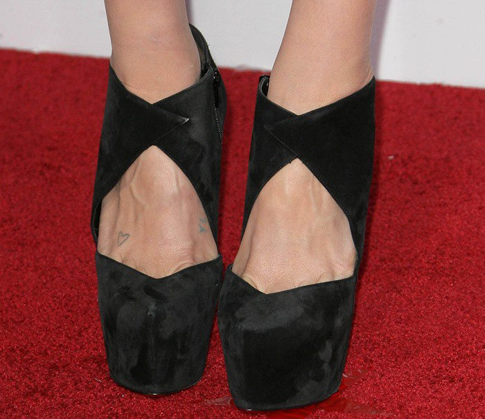 Kesha shows off her feet in black Christian Louboutin X Mugler Fall 2012 Donue 160 booties