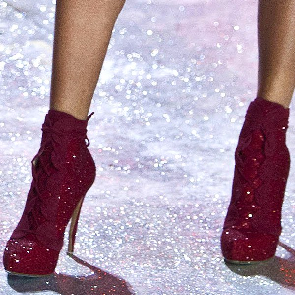 South African model Candice Swanepoel wears glittering red ankle boots