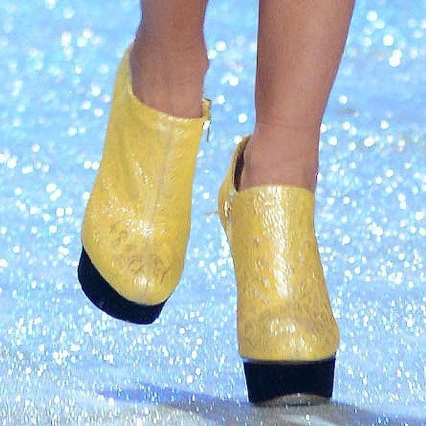 Miranda Kerr wears gold-colored platform boots