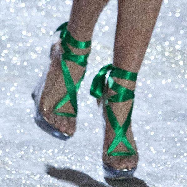 American model Hilary Rhoda wears green heels