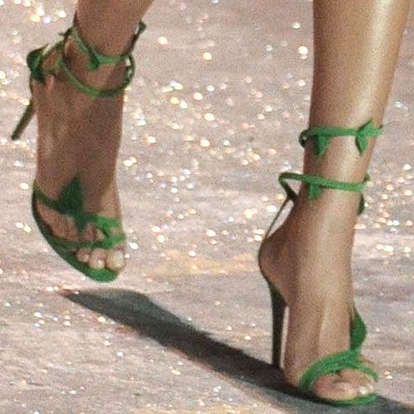 Shanina Shaik shows off her feet in green sandals