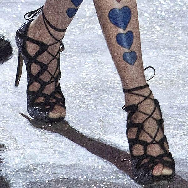 Chinese model Liu Wen shows off her feet in black heels