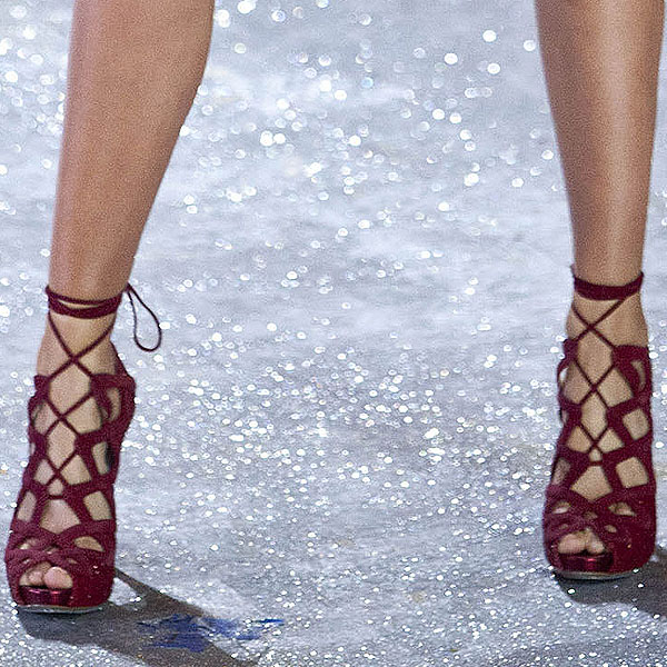 Miranda Kerr shows off her feet in glittering red shoes