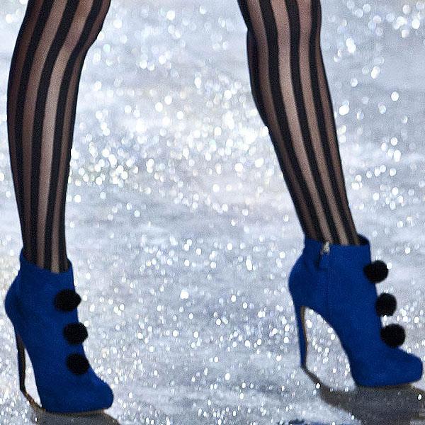Model Toni Garrn wears blue ankle boots by Nicholas Kirkwood