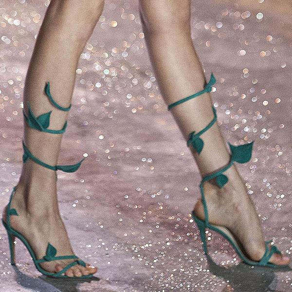 Namibian model Behati Prinsloo shows off her feet in leaf-embellished sandals