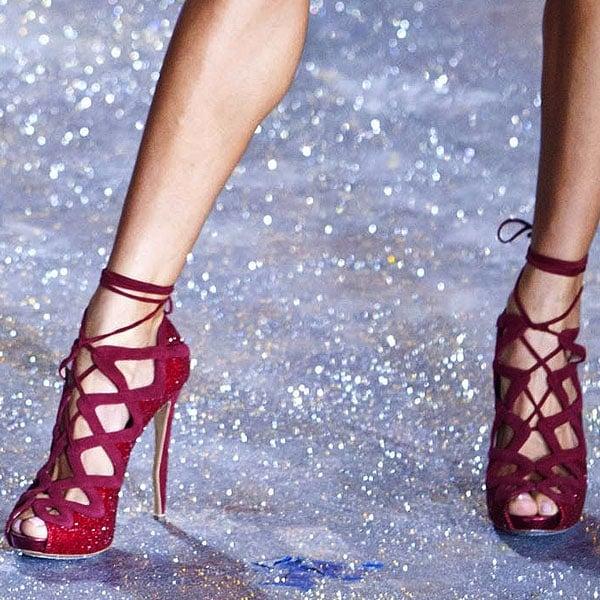 Brazilian model Alessandra Ambrosio shows off her feet in glittering red heels