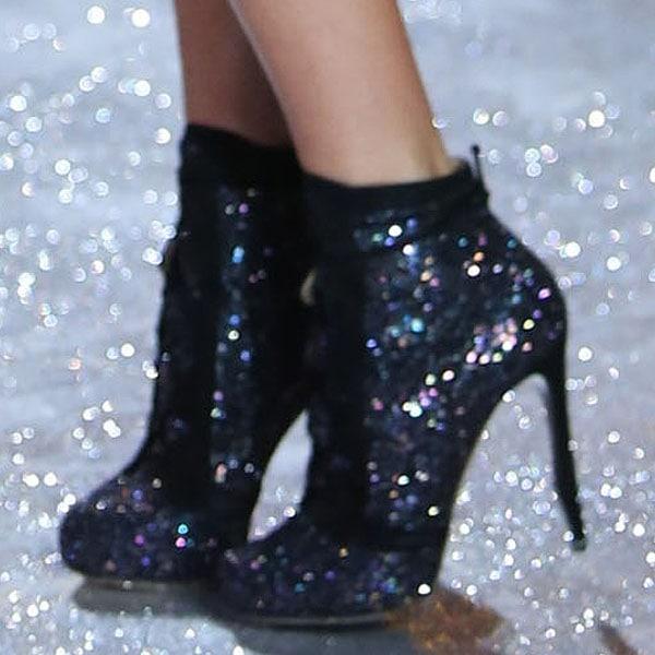 Dutch model Doutzen Kroes wears glittering black shoes