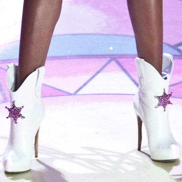 Angolan-Portuguese fashion model Sharam-Sharam Diniz rocks white embellished boots