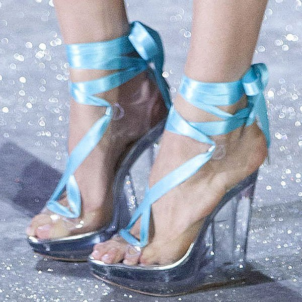 Barbara Fialho shows off her feet in PVC wedges