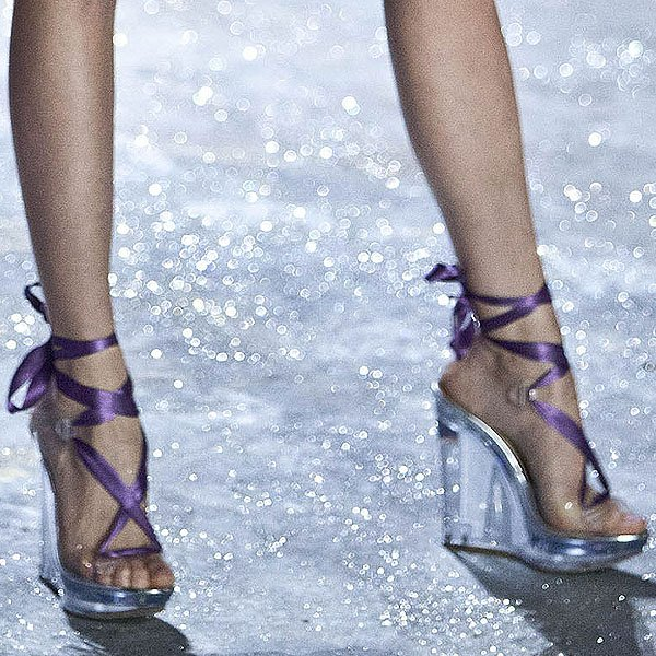 Behati Prinsloo shows off her feet in plastic lace-up wedges