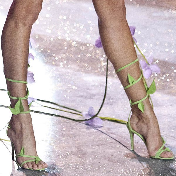 South African model Candice Swanepoel shows off her pretty feet in leaf-embellished sandals