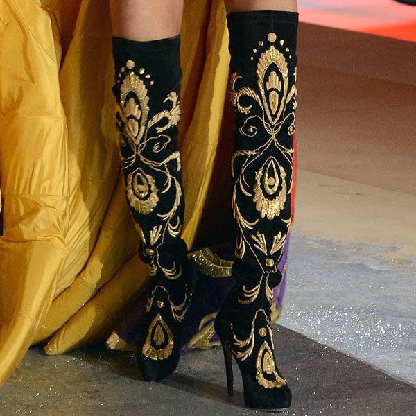 Adriana Lima wears black embellished boots by Nicholas Kirkwood