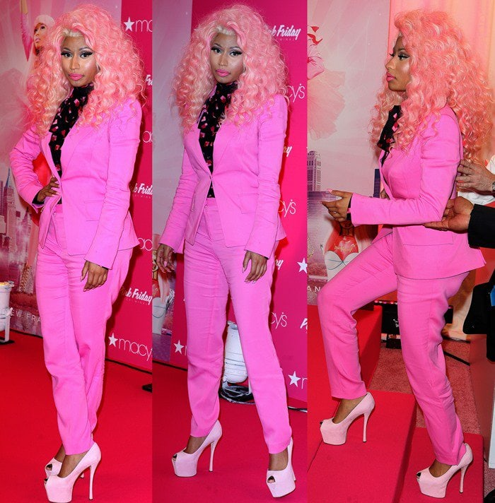 Nicki Minaj wore a fuchsia pink pants suit with a pair of lighter pink Giuseppe Zanotti peep-toe pumps