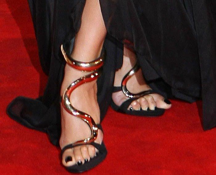 Nicole Scherzinger's feet inGiuseppe Zanotti sandals with snakelike gold straps
