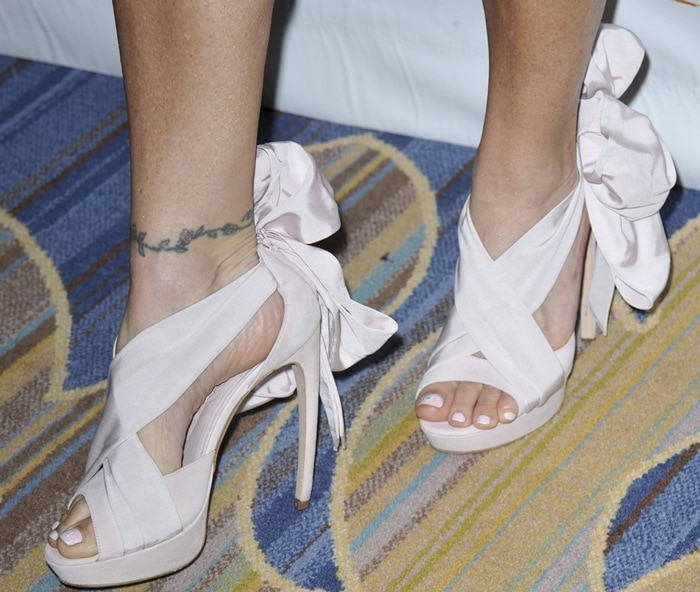 Sandi Taylor shows off her feet insandals featuring a large bow-tie detail