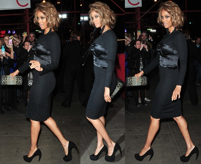 Tyra Banks wearinga corset-detailed black dress