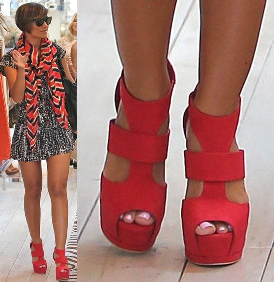 Frankie Sanford in strappy platform sandals