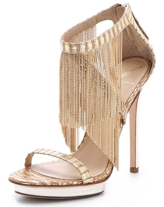 Delicate chain fringe swings from the crisscross ankle straps of these sexy platform sandals