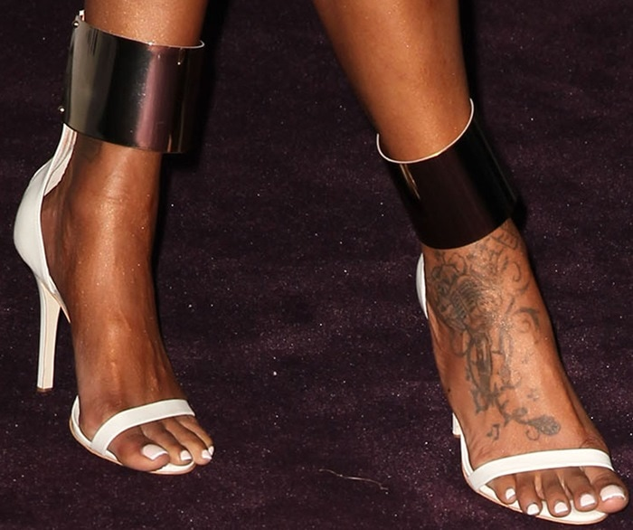 Brandy Norwood shows off her feet in metal-ankle-cuff leather sandals