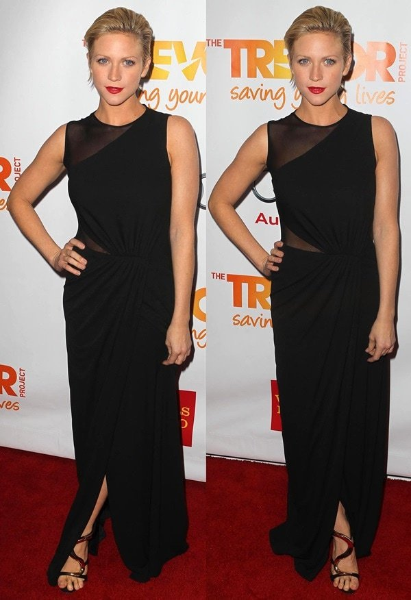 Brittany Snow styled the black suede Giuseppe Zanotti sandals with an elegant sleeveless Halston column dress featuring sheer panels