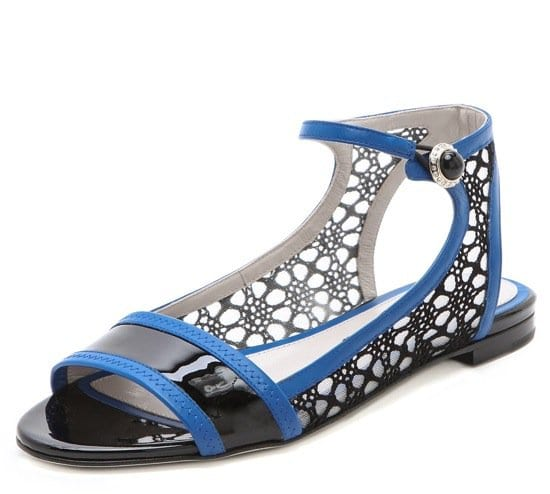 A sweet, yet bold pair of Jason Wu sandals, rendered in sleek patent leather and charming lace