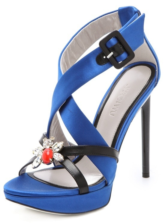This pair of satin platform sandals from Jason Wu affects a striking silhouette with thin, dark crisscross straps and a bright crystal cluster